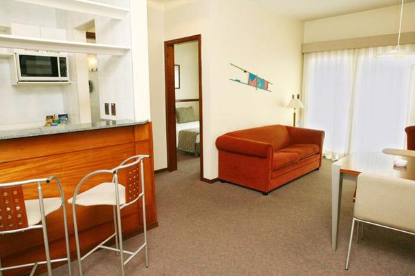 quarto com sala de estar hotel transamerica jundiai